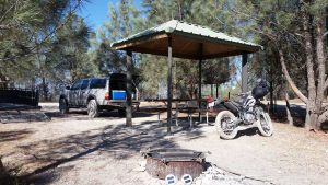 The campsite showing fire ring, canopy, picnic table.